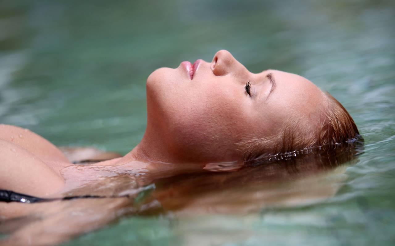 Woman in the pool in our spa near Béziers, in Château St Pierre de Serjac.